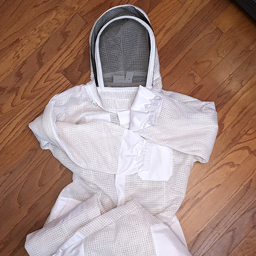 Photo of a beekeeper suit, laying on the floor