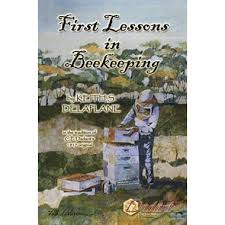 "Book cover of ""First Lessons in Beekeeping"". Cover is a painting of a beekeeper in a bee suit, working with hives."