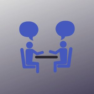 icon of two people at a table, facing each other, talking